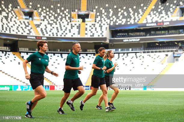 Assistant referee Michelle O'Neill of the Republic of Ireland fourth official Cuneyt Cakir of Turkey main referee Stephanie Frappart of France and...