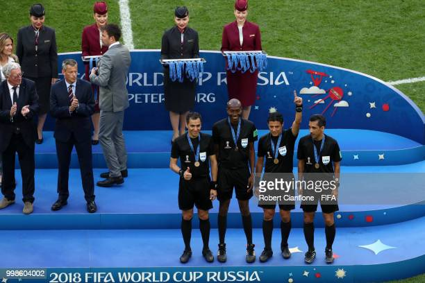 Assistant referee Mohammadreza Mansouri Fourth official Malang Diedhiou Referee Alireza Faghani and Assistant referee Reza Sokhandan are awarded...