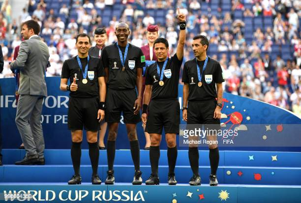 Assistant referee Mohammadreza Mansouri Fourth official Malang Diedhiou Referee Alireza Faghani and Assistant referee Reza Sokhandan pose with medals...