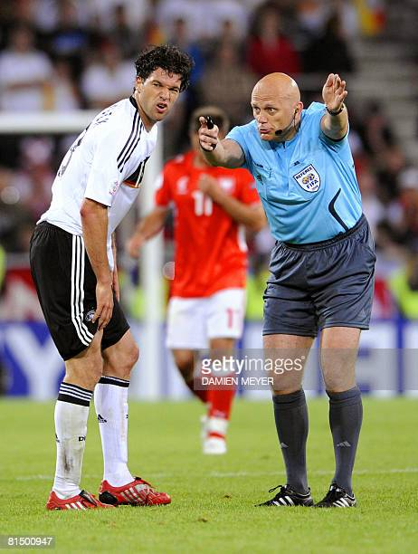 Assistant referee Norwegian Geir Age gestures towards German midfielder Michael Ballack during their Euro 2008 Championships Group B football match...