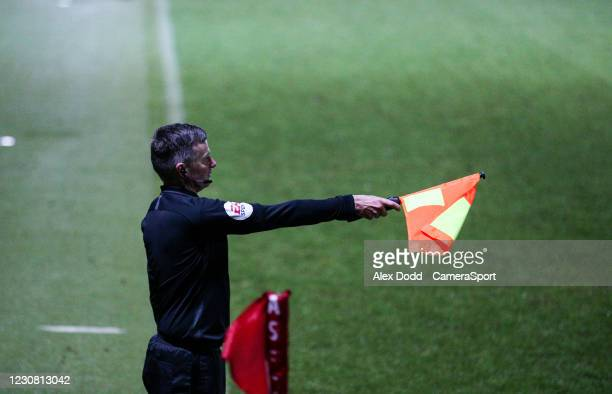 Assistant referee Paul Graham raises his flag as the goal scored by Hull City's Josh Magennis is ruled out for offside during the Sky Bet League One...