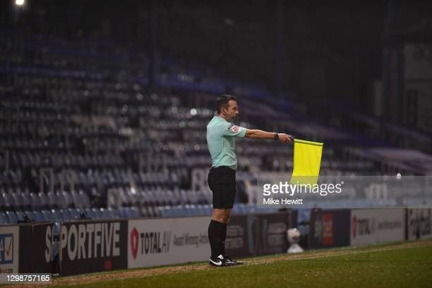 Assistant referee Paul Kelly signals offside in front of an empty stand during the Sky Bet League One match between Portsmouth and Lincoln City at...