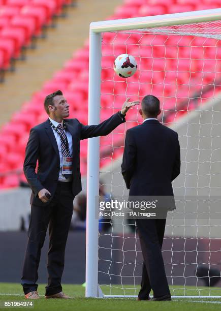 Assistant referee Scott Ledger and fourth official Michael Oliver test out the goalline technology before kickoff