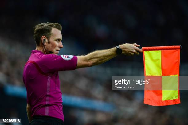Assistant Referee Scott Ledger holds his flag out for being offside during the Premier League match between Newcastle United and AFC Bournemouth at...