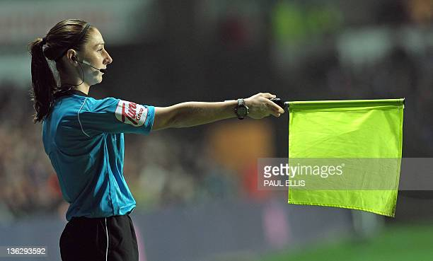 Assistant referee Sian Massey flags during the English Premier League football match between Swansea City and Tottenham Hotspur at Liberty Stadium in...