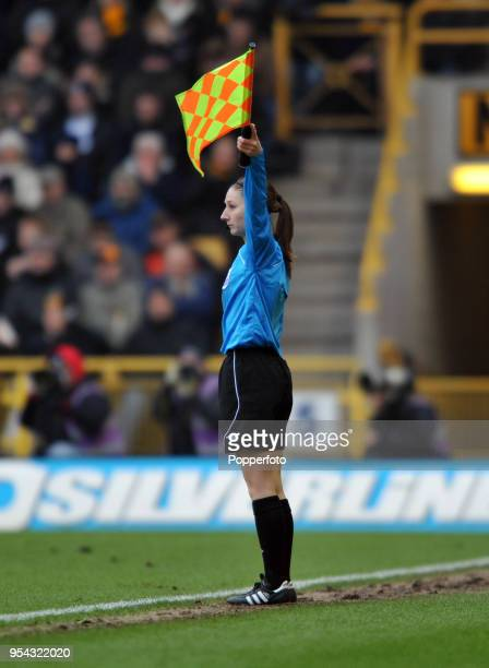 Assistant referee Sian Massey lifts the flag during the Barclays Premier League match between Wolverhampton Wanderers and Liverpool at Molineux on...