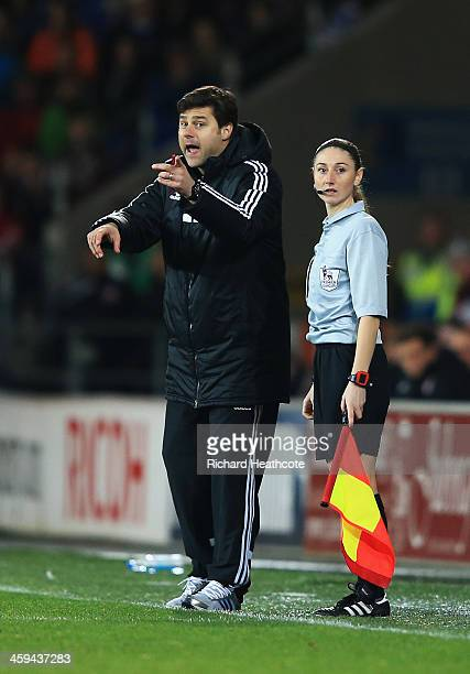 Assistant referee Sian Massey looks on as Mauricio Pochettino, manager of Southampton reacts during the Barclays Premier League match between Cardiff...