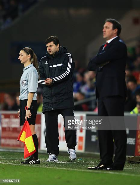 Assistant referee Sian Massey looks on with Malky Mackay, manager of Cardiff City and Mauricio Pochettino, manager of Southampton during the Barclays...