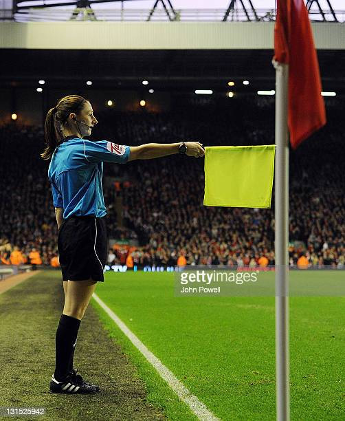 Assistant referee Sian Massey raises her flag during the Barclays Premier League match between Liverpool and Swansea City at Anfield on November 5,...