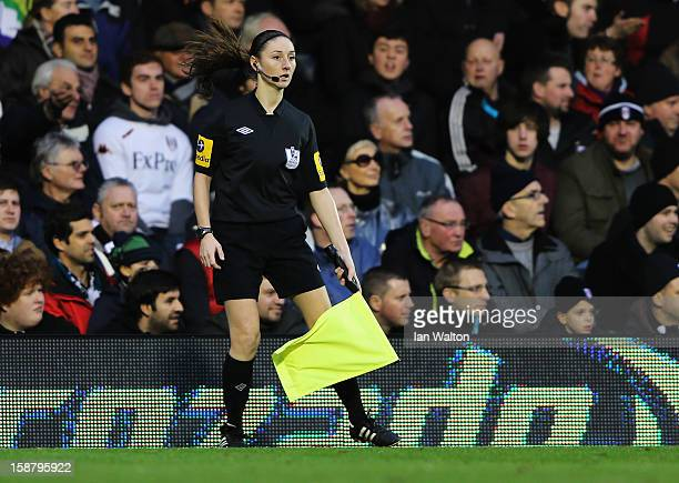 Assistant referee Sian Massey runs the line during the Barclays Premier League match between Fulham and Swansea City at Craven Cottage on December...