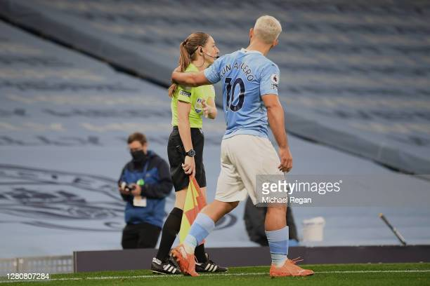 Assistant referee Sian Massey-Ellis and Sergio Aguero of Manchester City during the Premier League match between Manchester City and Arsenal at...