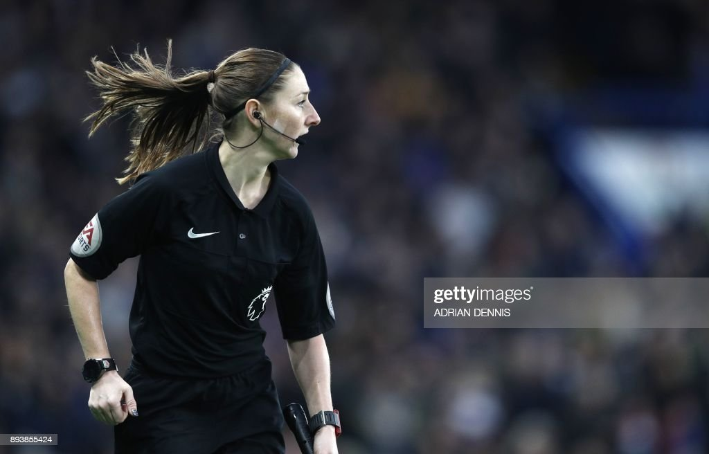 TOPSHOT - Assistant referee Sian Massey-Ellis follows play during the English Premier League football match between Chelsea and Southampton at Stamford Bridge in London on December 16, 2017. / AFP PHOTO / Adrian DENNIS / RESTRICTED TO EDITORIAL USE. No use with unauthorized audio, video, data, fixture lists, club/league logos or 'live' services. Online in-match use limited to 75 images, no video emulation. No use in betting, games or single club/league/player publications. /