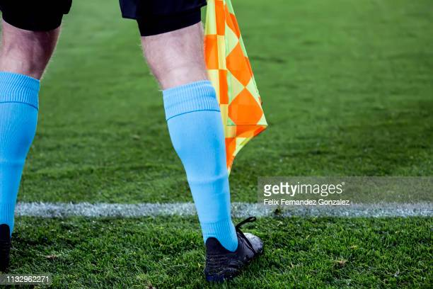 assistant referee signals with flag in the soccer field - referee stock pictures, royalty-free photos & images