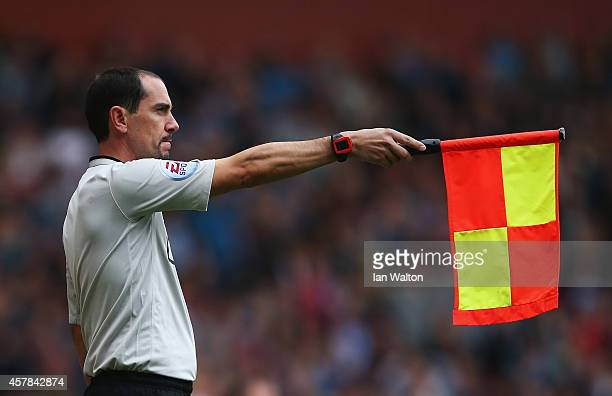 Assistant referee Stephen Child signals for offside during the Barclays Premier League match between West Ham United and Manchester City at Boleyn...