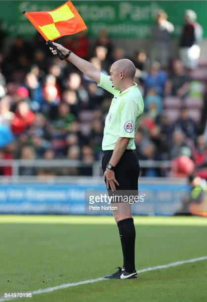 Assistant Referee Thomas Harty raises his flag to give an offside decision during the Sky Bet League One match between Northampton Town and Doncaster...