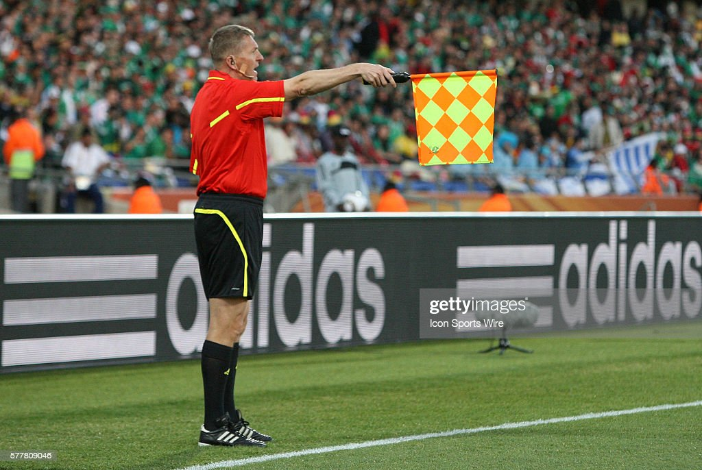 Assistant referee Tibor Vamos (HUN) signals offsides. The Mexico National Team lost 1-2 to the Uruguay National Team at Royal Bafokeng Stadium in Rustenburg, South Africa in a 2010 FIFA World Cup Group A match.
