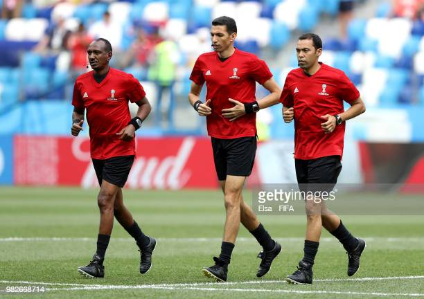 Assistant referee Waleed Ahmed referee Ghead Grisha and assistant referee Redouane Achik warm up prior to the 2018 FIFA World Cup Russia group G...