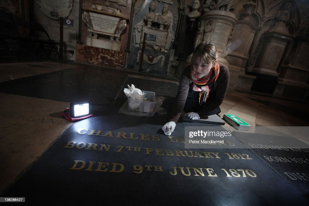 Assistant Restorer Lucy Ackland cleans the gravestone of Charles Dickens at Westminster Abbey on February 1, 2012 in London, England. A wreath laying ceremony will take place at The Abbey on February 7, 2012 to mark the bicentenery of Dicken's birth. The Prince of Wales, The Duchess of Cornwall and descendants of the celebrated Victorian writer will attend.