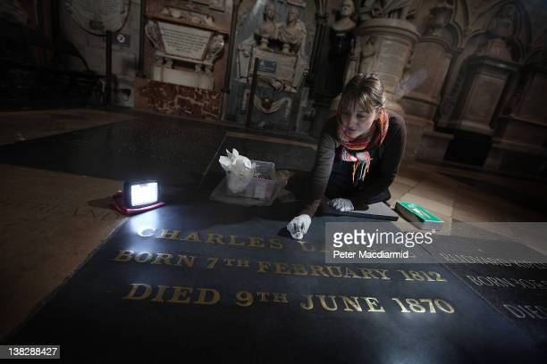 Assistant Restorer Lucy Ackland cleans the gravestone of Charles Dickens at Westminster Abbey on February 1 2012 in London England A wreath laying...