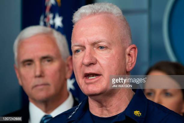Assistant Secretary for Health and head of the Public Health Service Admiral Brett Giroir standing with US Vice President Mike Pence and members of...