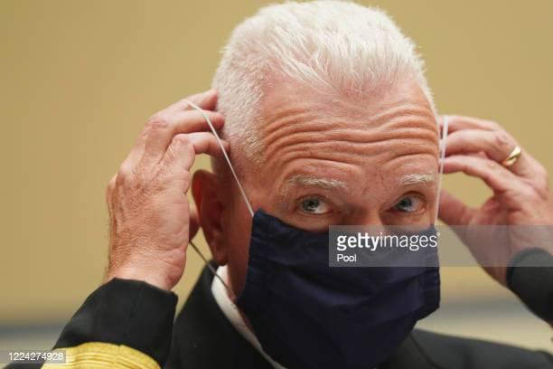 S Assistant Secretary for Health and Human Services Admiral Brett P Giroir adjusts his protective face mask as he testifies before a House Select...