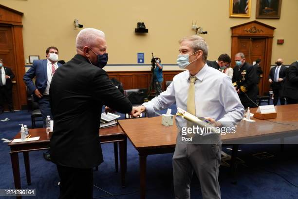 S Assistant Secretary for Health and Human Services Admiral Brett P Giroir offers an elbow bump to US Rep Jim Jordan and gets a fist bump in return...