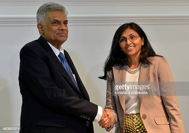 US Assistant Secretary of state for South and Central Asia Nisha Biswal shakes hands with Sri Lankan Prime Minister Ranil Wickremasinghe in Colombo...