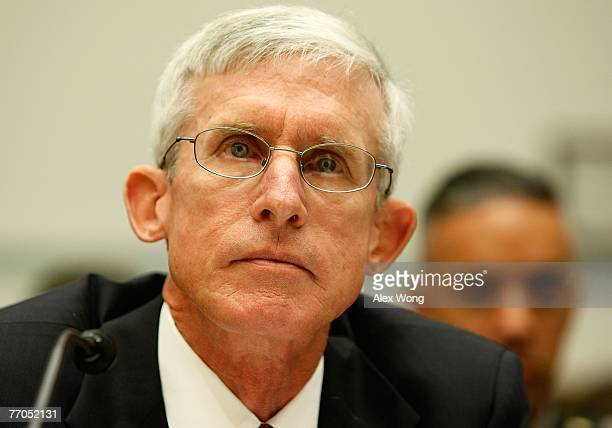 Assistant Secretary of Veterans Affairs for Policy and Planning Patrick Dunne listens as he testifies during a hearing before the National Security...