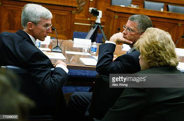 Assistant Secretary of Veterans Affairs for Policy and Planning Patrick Dunne talks to an unidentified aide as Principal Deputy Under Secretary of...