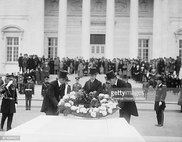 Assistant Secretary of War Dwight Davis US President Calvin Coolidge and Secretary of the Navy Curtis D Wilbur Laying Wreath on Tomb of the Unknown...