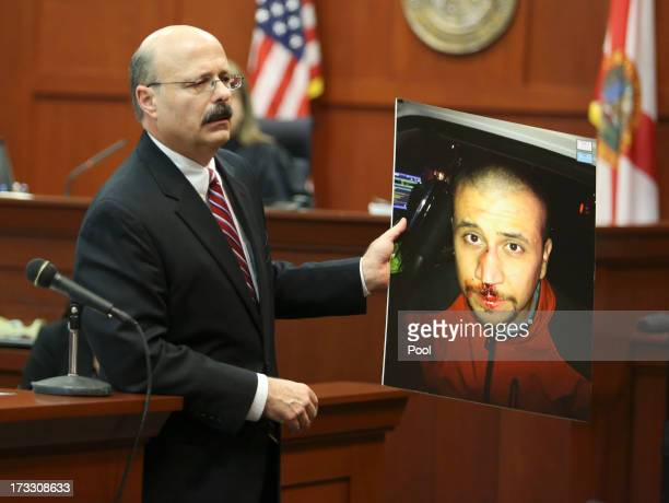 Assistant state attorney Bernie de la Rionda shows a picture of George Zimmerman to the jury while presenting the state's closing arguments against...