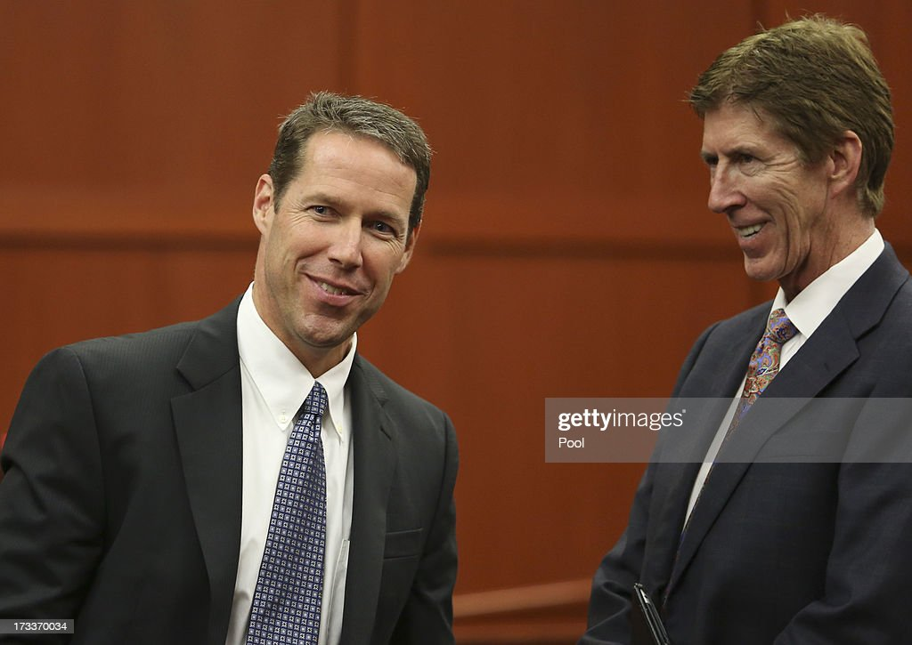 Assistant state attorney John Guy (L), and defense attorney Mark O'Mara laugh at the end of the day during George Zimmerman's trial in Seminole circuit court July 12, 2013 in Sanford, Florida. Judge Debra Nelson has ruled that the jury can also consider a lesser manslaughter charge along with the second-degree murder charge in the shooting death of Trayvon Martin.