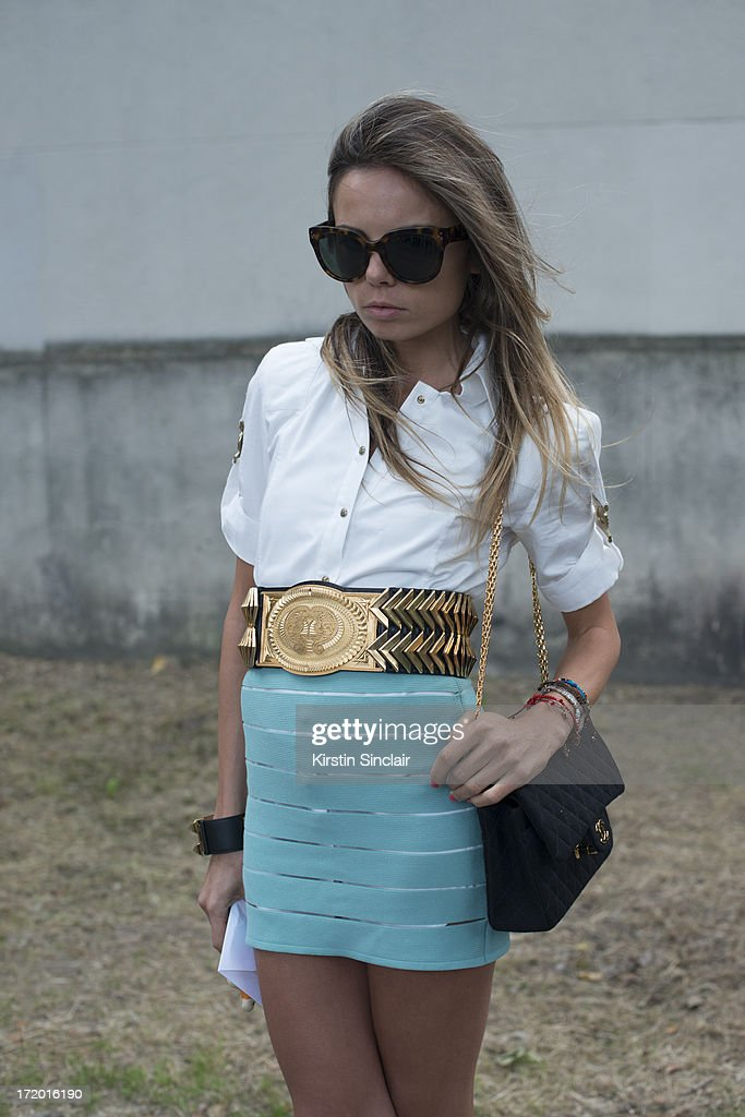 Assistant to Anna Dello Russo at Vogue Japan wears Celine sunglasses, Chanel bag, Balmain skirt, shirt and belt and an Hermes bracelet on day 4 of Paris Collections: Men on June 29, 2013 in Paris, France.