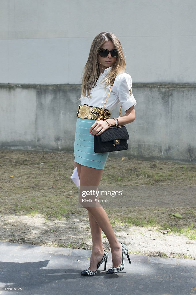 Assistant to Anna Dello Russo at Vogue Japan wears Tom Ford shoes, Celine sunglasses, Chanel bag, Balmain skirt, shirt and belt and an Hermes bracelet on day 4 of Paris Collections: Men on June 29, 2013 in Paris, France.
