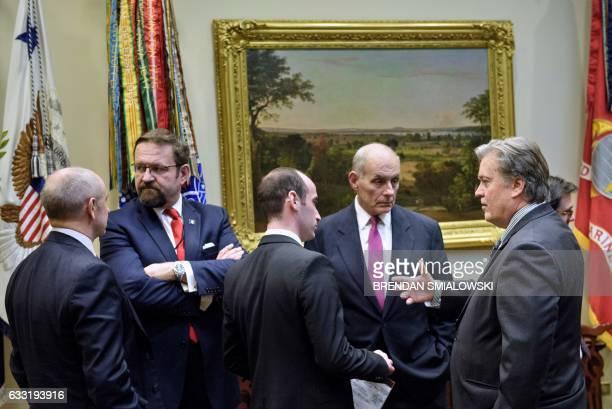 Assistant to the President Chris Liddella advisor Stephen Miller US Secretary of Homeland Security John Kelly and Trump advisor Steve Bannon talk...