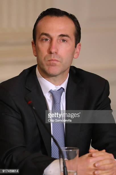 Assistant to the President Reed Cordish attends a meeting with US President Donald Trump to unveil his administration's longawaited infrastructure...