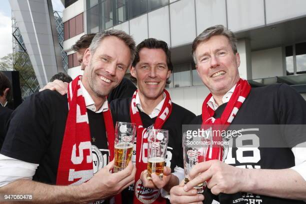 assistant trainer Andre Ooijer of PSV Chris van der Weerden Physical trainer Egid Kiesouw of PSV during the champions parade during the PSV champions...