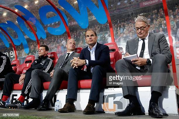 assistant trainer Dennis Bergkamp of Ajax coach Frank de Boer of Ajax assistant trainer Henny Spijkerman of Ajax during the Dutch Eredivisie match...