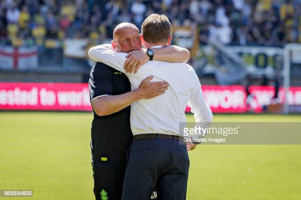 assistant trainer Dirk Heesen of ADO Den Haag coach Alfons Groenendijk of ADO Den Haag celebrate the victory and the qualification for the Play Offs...