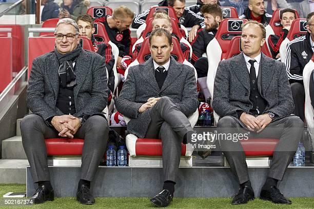assistant trainer Hennie Spijkerman of Ajax coach Frank de Boer of Ajax assistant trainer Dennis Bergkamp of Ajax during the Dutch Eredivisie match...