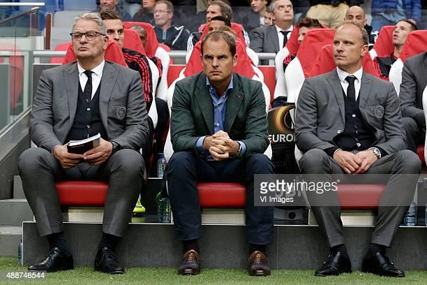 assistant trainer Henny Spijkerman of Ajax coach Frank de Boer of Ajax assistant trainer Dennis Bergkamp of Ajax during the UEFA Europa League group...