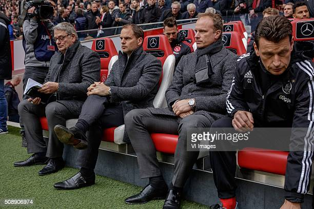assistant trainer Henny Spijkerman of Ajax coach Frank de Boer of Ajax assistant trainer Dennis Bergkamp of Ajax during the Dutch Eredivisie match...