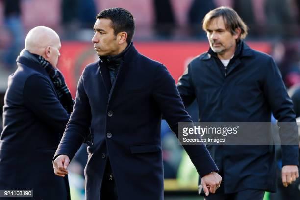 assistant trainer Jan Wouters of Feyenoord coach Giovanni van Bronckhorst of Feyenoord coach Phillip Cocu of PSV during the Dutch Eredivisie match...