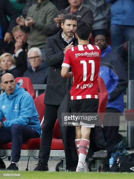 PSV assistant trainer Jurgen Dirkx PSV coach Mark van Bommel Hirving Lozano of PSV during the Dutch Eredivisie match between PSV Eindhoven and Ajax...