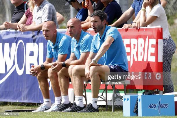 Assistant trainer Reinier Robbemond of PSV Assistant trainer Jurgen Dirkx of PSV Coach Mark van Bommel of PSV during the Friendly match between...