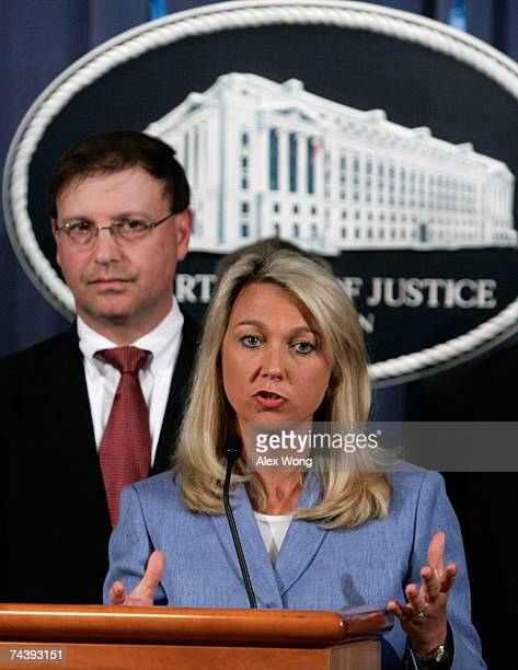 Assistant US Attorney General Alice Fisher speaks as US Attorney Chuck Rosenberg of Eastern District of Virginia looks on during a news conference at...