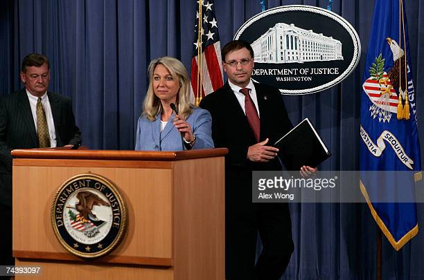 Assistant US Attorney General Alice Fisher takes the podium with US Attorney Chuck Rosenberg of the Eastern District of Virginia and Assistant...
