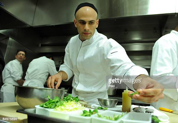 Assistant White House Chef Sam Kass prepares winter citrus salad for tonight during the Governors' dinner preview in the White House kitchen on...