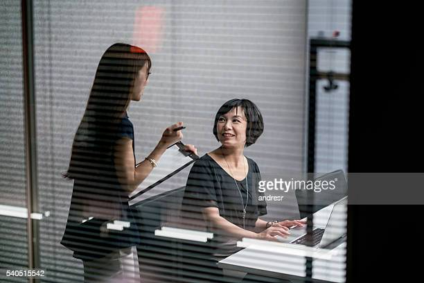 Assistant working for a business woman