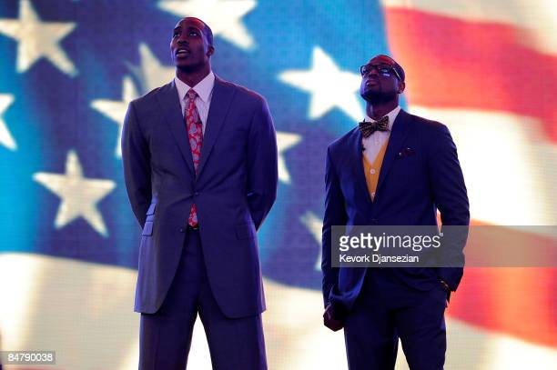 Assistantcoach Dwight Howard of the Sophomore team and assistant coach Dwyane Wade of the Rookie team stand during the anthem before the TMobile...